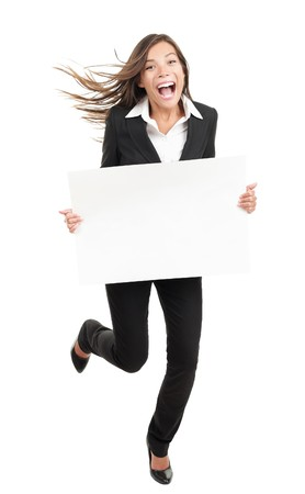 excited business woman: Blank sign business woman. Funny full length of young woman holding white empty billboard or placard. Beautiful mixed race chinese asian  caucasian woman isolated on white background.  Stock Photo