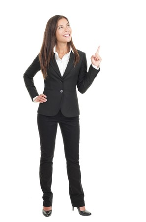 copyspace: Businesswoman pointing  showing in full length isolated on white background. Young confident mixed race chinese  caucasian woman business woman. Stock Photo