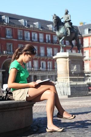 Madrid, Spain - woman tourist on Plaza Mayor in summer.