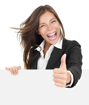 Excited woman thumbs up with blank poster sign. Young businesswoman mixed asian caucasian ethnicity.