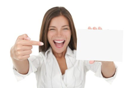 Woman pointing excited at blank card sign with copy space. Woman in white shirt isolated on white background Stock Photo - 7400395
