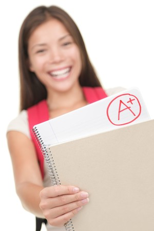 Grade / test results. Female student showing perfect grade A plus. Isolated on white background, focus on grades.