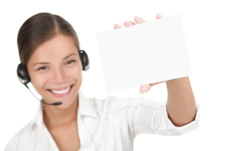 Customer service representative with headset holding a blank empty card. Isolated on white background.