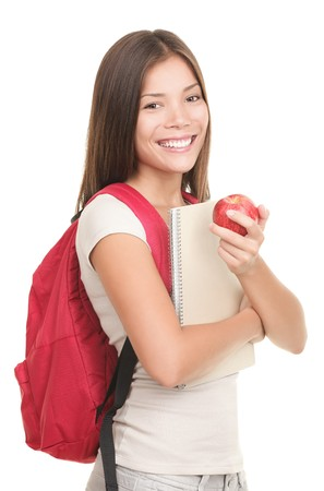 Student on white. Female mixed asian  caucasian college student isolated on white background holding a red apple. Stock Photo