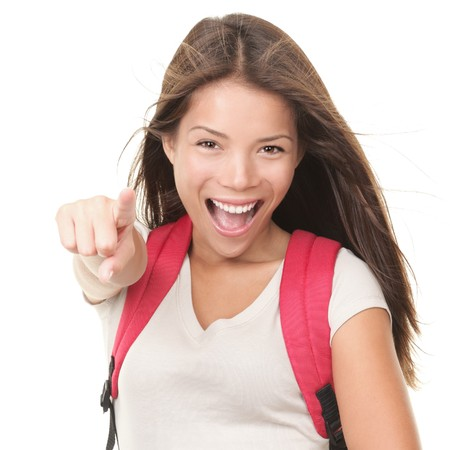 shout: Female university student pointing excited and happy. Isolated on white background. Young mixed white  chinese model wearing school bag.