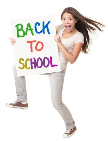 Regreso a la escuela / Universidad / college. Estudiante de celebrar un signo diciendo que regreso a la escuela. Happy emocionados a gritos mujer blanca / China, aislada en un fondo blanco en longitud completa  Foto de archivo - 7439074