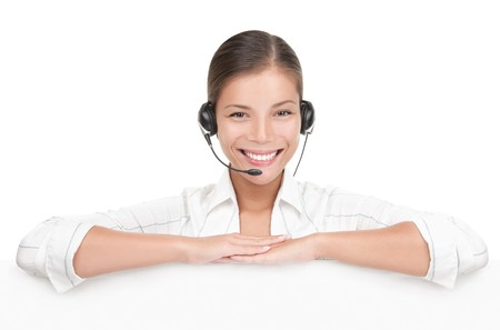 peeking: Headset customer service woman showing blank billboard sign isolated on white background. Mixed race young Chinese Asian   Caucasian woman.