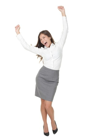 arm raised: Success woman celebrating in winner dance. Casual young successful businesswoman dancing very happy. Full length Isolated on white background.