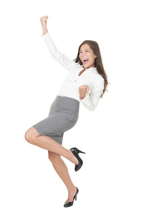 young cheering: Successful young business woman happy for her success. Isolated full body image on white background. Mixed Asian  Caucasian businesswoman.