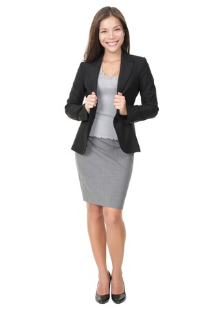 skirt suit: Businesswoman in full length confident, smiling and ready! Isolated on white background. Young mixed race Chinese  white female model.