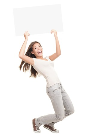 above head: Poster sign woman excited standing in full length - funny and energetic pose. Young Caucasian  Asian female model isolated on white background.