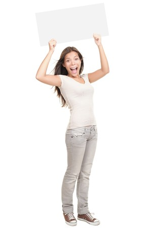 Blank sign. Woman holding empty blank white sign above her head. Excited and screaming beautiful young woman isolated on white background standing in full length.  photo