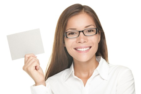 Woman showing blank sign smiling happy, Young casual professional with glasses showing empty card sign. Portrait of young professional Asian / Caucasian female model isolated on white background. Stock Photo - 7755954