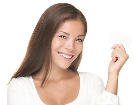 Business card woman. Young casual smiling swoman  showing blank business card sign isolated on white background. Young mixed race Chinese Asian / Caucasian model isolated on white background. Stock Photo - 7755959