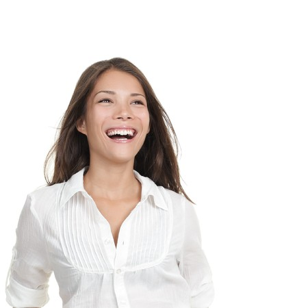 Smiling laughing woman portrait - looking at copy space. Beautiful young mixed Chinese Asian / Caucasian woman close-up. Stock Photo - 7755942