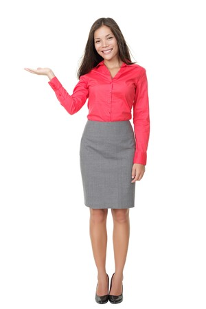 suit skirt: Woman showing product with open hand palm. Isolated on white background. Beautiful young mixed Asian Chinese  white Caucasian woman standing in full length.