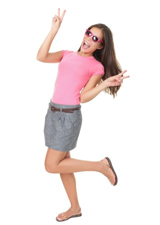 Funny woman dancing showing victory hand sign wearing cheap red sunglasses. Asian  Caucasian model isolated on white background in full length.  photo
