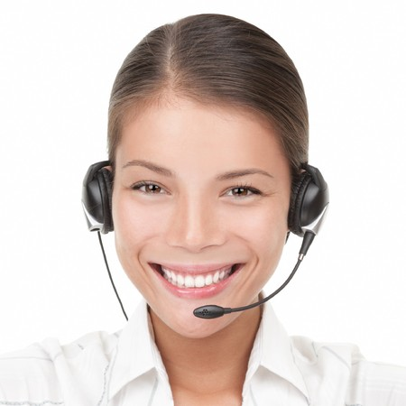 Headset woman from call center. Portrait close-up of young smiling woman from call center wearing headset. Isolated on white background. Mixed Asian / Caucasian woman Stock Photo - 7755969