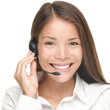 Customer Service woman smiling talking on headset. Close up portrait of beautiful young Caucasian  Asian.  Stock Photo