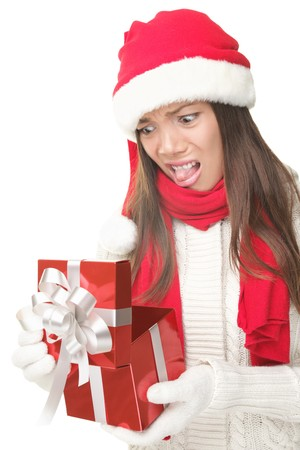 disappointed: Christmas Gift - woman opening gift disappointed and unhappy, Young woman in Santa hat. Funny cute photo of Asian  Caucasian woman isolated on white background.