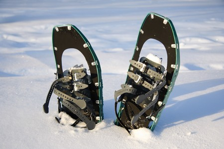 snowshoeing: Snowshoeing. Snowshoes in the snow. Photo from Quebec, Canada.