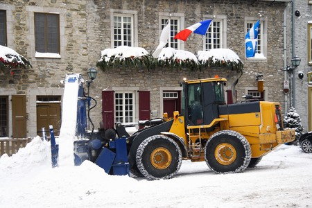 snow on the ground: Snow removal vehicle removing snow after blizzard in Quebec City, Canada.