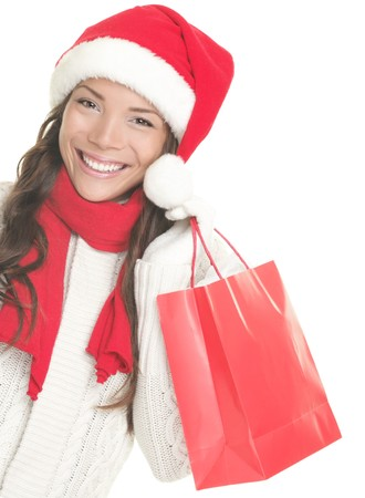 Christmas shopping woman isolated on white background. photo