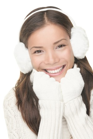 muff: Winter beauty woman smiling playful, cute and happy looking at camera. Portrait of mixed Asian  Caucasian young woman isolated on white background