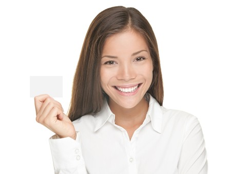 Woman showing blank business card. Young beautiful asian businesswoman standing isolated on white background. photo