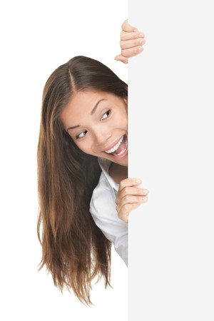 surprised face: Blank sign. Woman surprised looking at white billboard. Isolated on white background. Stock Photo