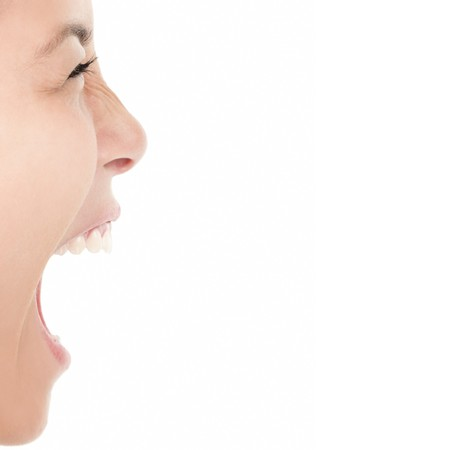 Screaming woman isolated on white background - closeup. photo