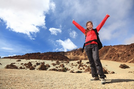 Woman hiker excited and cheerful travelling on Teide, Tenerife, Canary Islands. photo