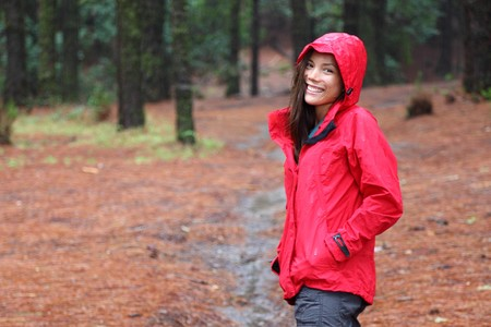 Woman smiling walking in forest on a rainy day. The forest La Esperanza, Tenerife, Canary Islands. photo