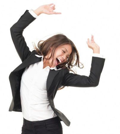 excited business woman: Portrait of successful winner celebrating by dancing. Beautiful young happy woman isolated on white background. Stock Photo