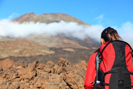 challenges ahead: Woman hiking looking at challenges ahead. The peak is Pico Viejo on the volcano Teide, Tenerife.