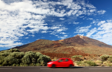 scenic drive: Road trip car in beautiful landscape with copy space. Mountains and volcano Teide, Tenerife in the background