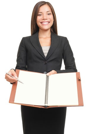 Business woman writing  signing in paper document . Asian professional isolated on white background.  photo