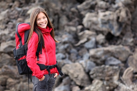 backpacking: Smiling young woman hiker hiking outdoors. Portrait of mixed race Asian  Caucasian model. Photo from Teide, tenerife.