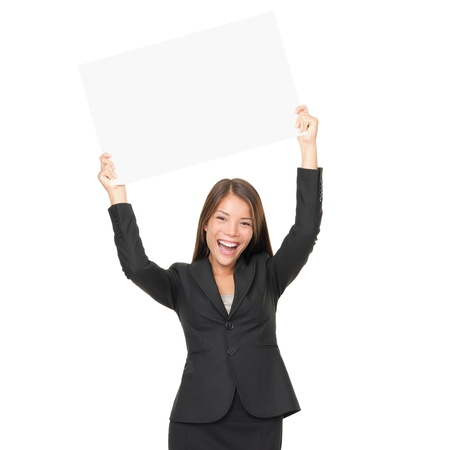 Portrait of beautiful businesswoman holding blank billboard over her head. Isolated on white backgound photo