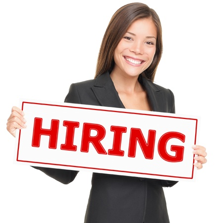 job advertisement: Job woman showing hiring sign. Young smiling Caucasian  Asian businesswoman isolated on white background.