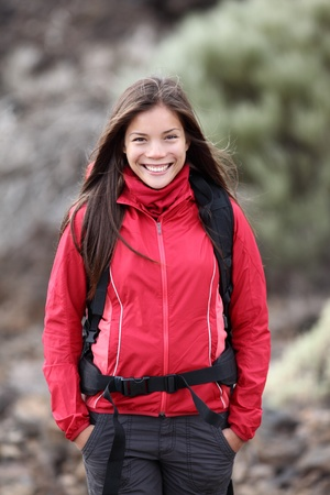 Outdoors woman portrait of young and beautiful hiking woman - very fresh outdoor look.  photo