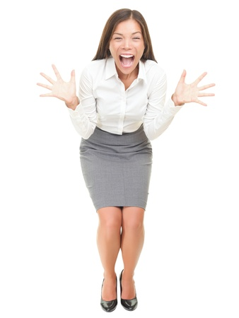 crazy woman: Crazy excited businesswoman screaming. Full length portrait of mixed race Asian  Caucasian female model isolated on white background. Stock Photo