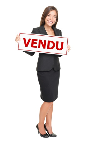 French real estate agent holding french sold sign - agent immobilier avec pancarte vendu