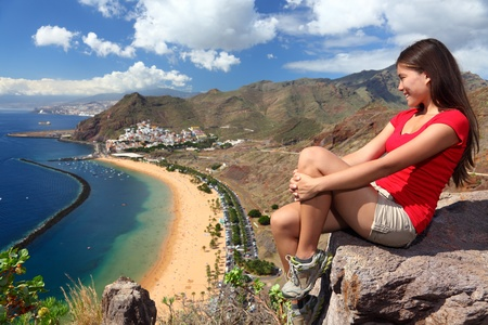 Tenerife. Woman traveler tourist looking at beach view. Playa de las Teresitas, Tenerife, Canary Islands, Spain. Stock Photo