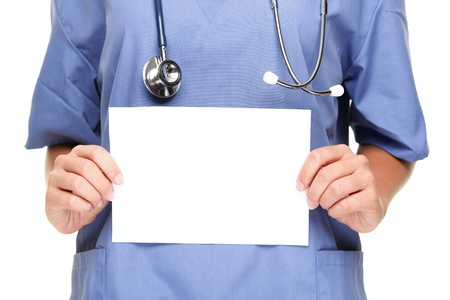 Doctor or woman nurse showing blank empty sign with copy space for text. Isolated on white background. Stock Photo - 8548806