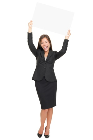 above head: Celebrating happy business woman winner showing empty blank sign above her head. Isolated on white background.