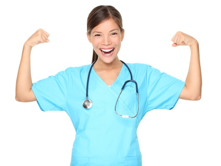 Nurse woman showing arm muscles smiling. Funny photo of successful young female nurse in blue scrub. Asian Caucasian woman isolated on white background. Stock Photo - 8548771