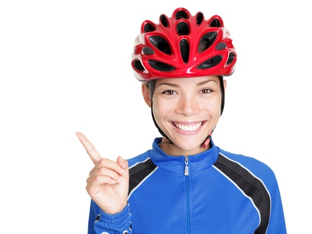 fahrradfahrer: Woman wearing Fahrrad Fahrradsturzhelm pointing at textfreiraum isolated on white Background. Beautiful young asian chinesischen  wei� caucasian Woman in Bike Outfit und red Bike Helm