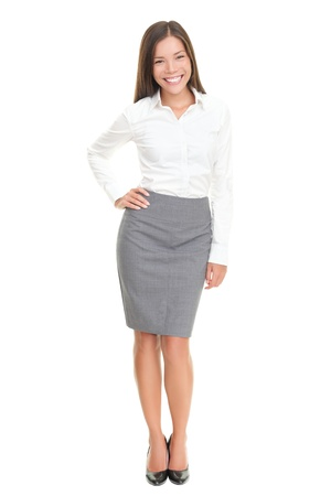Cheerful business lady standing posing and laughing. Isolated on white background. Stock Photo - 8548897