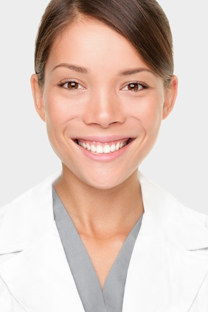 Pharmacist. Portrait of young professional woman pharmacist or scientist in lab coat. Smiling mixed race Caucasian  Asian woman. photo